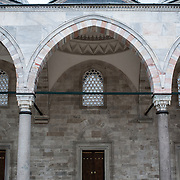The courtyard of Suleymaniye Mosque in Istanbul. Dedicated to Suleiman the Magnificent (or Suleiman I), the longest-reigning Ottoman Sultan (1520-1566), Süleymaniye Mosque stands prominently on Istanbul's Third Hill and is considered the city's most important mosque. It was completed in 1558.