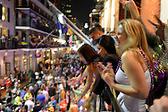 People crowd the balconies and streets of the French Quarter during Mardi Gras 2013