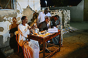 Groom's family receiving money from guests, each donation is written next to the name of the guest