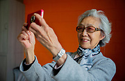 Senior Chinese Woman Taking Selfie