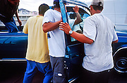 02 AUGUST 2001 - PHOENIX, ARIZONA, USA: Day laborers at the corner of Thomas Rd and 36th Street in Phoenix clamor for work when a pick up truck stops at the corner. Many of the day laborers who look for work on valley street corners are undocumented immigrants. .PHOTO BY JACK KURTZ