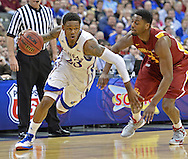 Mar 15, 2013; Kansas City, MO, USA; Kansas Jayhawks guard Ben McLemore (23) drives by Iowa State Cyclones forward Melvin Ejim (3) in the first half during the quarterfinals of the Big 12 tournament at the Sprint Center. Mandatory Credit: Peter G. Aiken-USA TODAY Sports