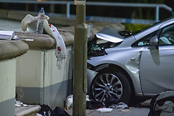 © Licensed to London News Pictures. 14/05/2020. London, UK. A blood covered item of material sits on a wall alongside a vehicle that has collided with a wall on Lombard Road. Police were called at around 1800BST on Wednesday, 13 May, to reports of a man with a knife in Lombard Road, SW11. There were also reports of a car in collision with a wall in Lombard Road. Officers attended the location and found two men injured - one had cuts to his arms and the other cuts to his legs. Officers believed the two men had been travelling in the car. Both have been taken to hospital, where their injuries are not believed to be life-threatening. Investigations at the scene led officers to Vicarage Crescent, SW11, where they found two other injured men. Both were taken to hospital with non life-threatening injuries. Photo credit: Peter Manning/LNP