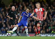 Chelsea's Cesc Fabregas tussles with Southampton's James Ward-Prowse during the Premier League match at Stamford Bridge Stadium, London. Picture date: April 25th, 2017. Pic credit should read: David Klein/Sportimage