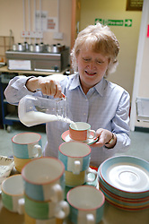 Age concern carers week; volunteer preparing refreshments in the kitchen,
