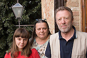 Daniela Ciolfi and Fabio Pelligrini with their daughter, Caterina on the balcony of their home. Revisit with the Pellegrini family, 2005, Pienza, Italy. The Pellegrinis were Italy's participants in Material World: A Global Family Portrait, 1994 (pages: 198-199), for which they took all of their possessions out of their house for a family-and-possessions-portrait. In 1996, UNESCO declared the town a World Heritage Site.