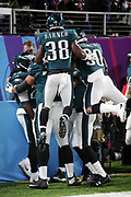 Philadelphia Eagles running back Kenjon Barner (38) and Philadelphia Eagles rookie running back Corey Clement (30) leap on Philadelphia Eagles running back LeGarrette Blount (29) in celebration after Blount runs for a 21 yard touchdown that gives the Eagles a 15-3 second quarter lead during the 2018 NFL Super Bowl LII football game against the New England Patriots on Sunday, Feb. 4, 2018 in Minneapolis. The Eagles won the game 41-33. (©Paul Anthony Spinelli)