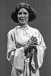 December 27, 2016 - File - CARRIE FRANCES FISHER (October 21, 1956 - December 27, 2016) was an American actress, screenwriter, author, producer, and speaker. She was known for playing Princess Leia in the Star Wars films. Fisher was also known for her semi-autobiographical novels, including Postcards from the Edge, and the screenplay for the film of the same name, as well as her autobiographical one-woman play, and its nonfiction book, Wishful Drinking, based on the show. Her other film roles included Shampoo (1975), The Blues Brothers (1980), Hannah and Her Sisters (1986), The 'Burbs (1989), and When Harry Met Sally (1989). Pictured: 1980's - New York, New York, U.S. - Carrie FIsher as Princess Leia (Credit Image: © Lynn Goldsmith via ZUMA Press)