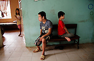 A smiling young girl looks around the door while two boys pass the time at a center for Agent Orange victims. The children manifest a variety of mental and physical disorders believed to be caused by the war time defoliant. Robert Dodge, a Washington DC photographer and writer, has been working on his Vietnam 40 Years Later project since 2005. The project has taken him throughout Vietnam, including Hanoi, Ho Chi Minh City (Saigon), Nha Trang, Mue Nie, Phan Thiet, the Mekong, Sapa, Ninh Binh and the Perfume Pagoda. His images capture scenes and people from women in conical hats planting rice along the Red River in the north to men and women working in the floating markets on the Mekong River and its tributaries. Robert's project also captures the traditions of ancient Asia in the rural markets, Buddhist Monasteries and the celebrations around Tet, the Lunar New Year. Also to be found are images of the emerging modern Vietnam, such as young people eating and drinking and embracing the fashions and music of the West. His book. Vietnam 40 Years Later, was published March 2014 by Damiani Editore of Italy.