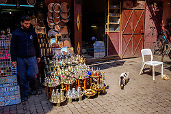 A man stands outside his shop in one of the narrow souks in the Medina in Marrakech, Morocco, North Africa<br /> <br /> <br /> <br /> (c) Andrew Wilson | Edinburgh Elite media