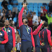 Basketball - Olympics: Day 16   DeAndre Jordan #6 of United States points to the heavens after the gold medal presentation during the USA Vs Serbia Men's Basketball Gold Medal game at Carioca Arena1on August 21, 2016 in Rio de Janeiro, Brazil. (Photo by Tim Clayton/Corbis via Getty Images)
