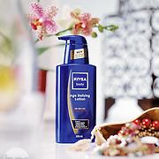 Studio product shot of Nivea body lotion created for a vogue magazine advert.<br /> Photographer Stuart Freeman.
