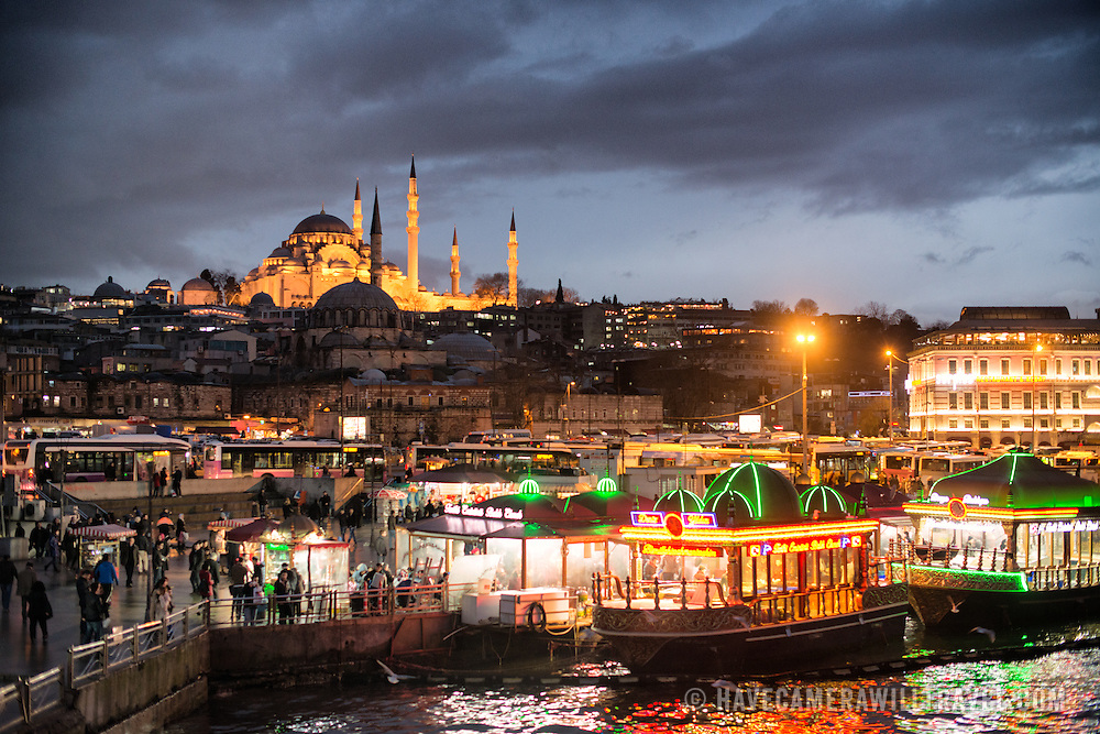 From a vantage point on the Galata Bridge, looking out over the Golden Horn and Eminonu waterfront, with Suleymaniye Mosque in the background. Dedicated to Suleiman the Magnificent (or Suleiman I), the longest-reigning Ottoman Sultan (1520-1566), Süleymaniye Mosque stands prominently on Istanbul's Third Hill and is considered the city's most important mosque. It was completed in 1558.