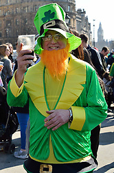 A man dressed as a Leprechaun in Trafalgar Square during the St Patrick's Day celebrations in London, Britain, on March 13, 2016. EXPA Pictures © 2016, PhotoCredit: EXPA/ Photoshot/ Ray Tang<br /> <br /> *****ATTENTION - for AUT, SLO, CRO, SRB, BIH, MAZ, SUI only*****