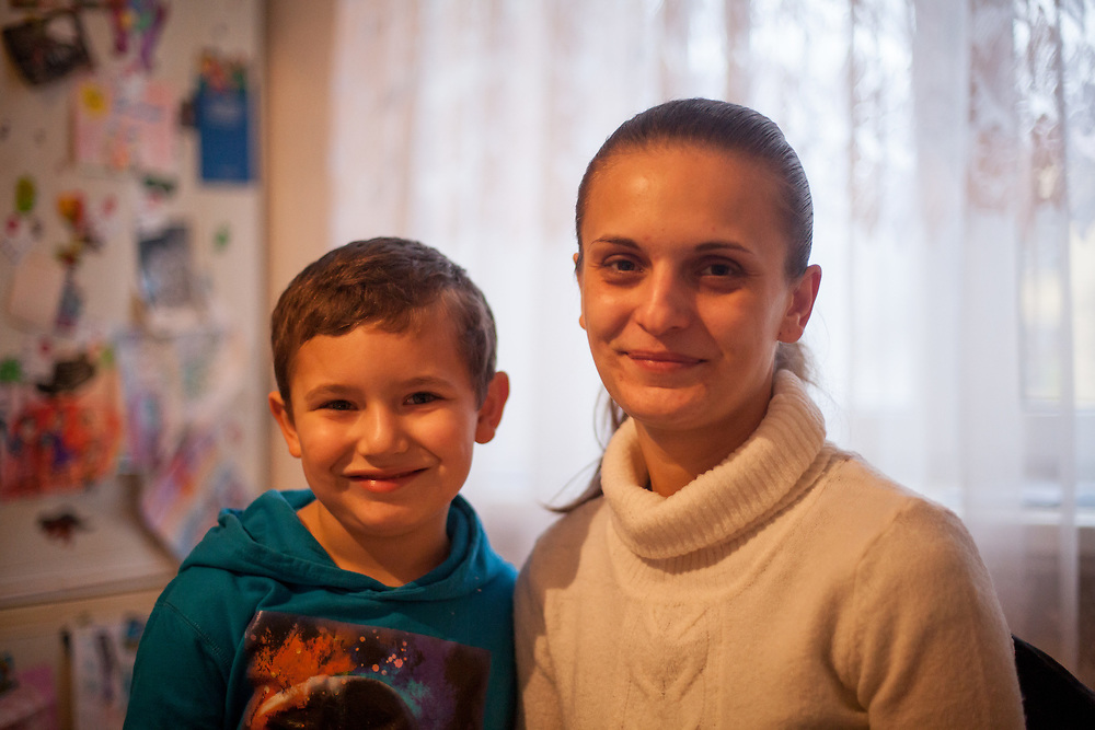 Andrea Danova (26) with her son Richard (6) during a meeting with volunteers and mothers with their children for consultation and data collection regarding school enrolments in Ostrava. The meeting was in a volunteers flat.