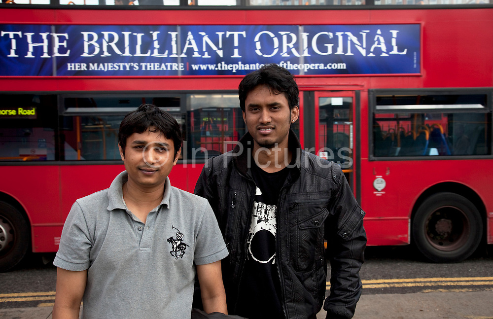 """Two Bangladeshi students in Stratford, East London. Jahanbin Reza, 25 (left) and Shakawoat Hossain Jahid, 22 (right) are bioth accounting students. Both finish their studies in July and are both very worried that there will be no work from them whn they graduate. They will have to leave the country and return home if there is no work. Shakawoat says """"I can stay maybe one more year. We contribute lots of money to the UK economy, so they must think of us"""". This is a relatively poor area of London, but in recent years has seen much regeneration, the construction of a major transport hub and various shopping complexes. Stratford is adjacent to the London Olympic Park and is currently experiencing regeneration and expansion linked to the 2012 Summer Olympics. (Photo by Mike Kemp/For The Washington Post)"""