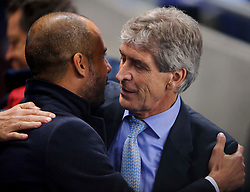 Bayern Manager Josep Guardiola (ESP) and Man City Manager Manuel Pellegrini (CHI) embrace before the match - Photo mandatory by-line: Rogan Thomson/JMP - Tel: Mobile: 07966 386802 - 02/10/2013 - SPORT - FOOTBALL - Etihad Stadium, Manchester - Manchester City v Bayern Munich - UEFA Champions League Group D.