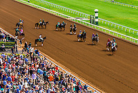 Race horses walking to the starting line on the dirt track  at Keeneland Racecourse, Lexington, Kentucky USA.