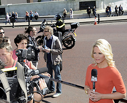 ©  licensed to London News Pictures. . UK.27/04/2011.Royal Wedding Preparations today in London with only two days to go before the big day..Fox news reporter outside Buckingham Palace.  sorry no name..Please see special instructions..Picture credit should read Grant Falvey/LNP......