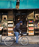street life bicycle groceries vegetables cycling deliveries blurred one person canopy