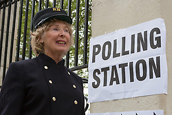© Licensed to London News Pictures. 07/05/2015. London, UK. A Chelsea Pensioner, a resident for former service personnel at the Royal Chelsea Hospital, London, arrives at her local polling station station in west London this morning. Photo credit : Vickie Flores/LNP