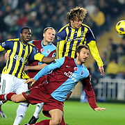 Fenerbahce's Diego Alfredo Lugano MORENO (C) and Trabzonspor's Remzi Giray KACAR (F) during their Turkish superleague soccer derby match Fenerbahce between Trabzonspor at the Sukru Saracaoglu stadium in Istanbul Turkey on Sunday 30 January 2011. Photo by TURKPIX