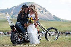 Chris Callens, editor of Cycle Source Magazine, and his new bride Heather on his custom Harley-Davidson panhead at the Broken Spoke Camground during the 75th Annual Sturgis Black Hills Motorcycle Rally.  SD, USA.  August 8, 2015.  Photography ©2015 Michael Lichter.