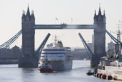 © Licensed to London News Pictures. 03/08/2018. London, UK.  The cruise ship Hamburg arrives under Tower Bridge in London this morning during another day of hot and sunny weather, as the heatwave returns to London.  Photo credit: Vickie Flores/LNP