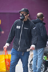 ©Licensed to London News Pictures 13/10/2020  <br /> Bromley, UK. A young man wearing a protective face mask. Autumnal wet weather this afternoon for shoppers in Bromley High Street, Bromley, South East London. Photo credit:Grant Falvey/LNP