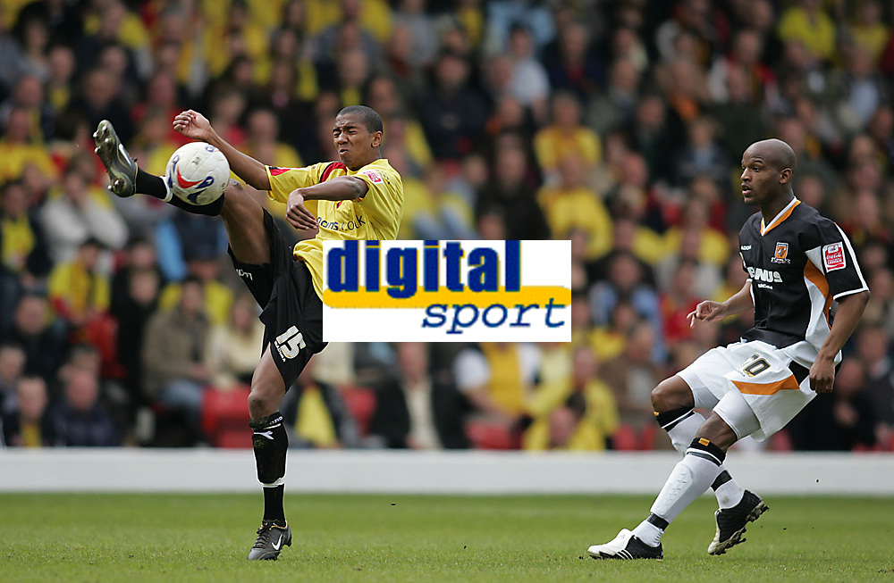 Photo: Lee Earle.<br /> Watford v Hull. Coca Cola Championship. 30/04/2006. Watford's Ashley Young (L) clears from Alton Thelwell.
