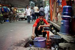 June 14, 2017 - Dhaka, Dhaka, Bangladesh - June 14, 2017 Dhaka, Bangladesh - A boy collect drinking water from a roadside water tap in old Dhaka. (Credit Image: © K M Asad via ZUMA Wire)