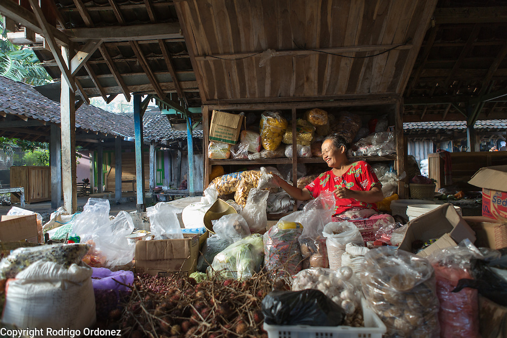 Mucina, 50, sells fruits, vegetables, and other merchandise at the market in Mulo, Wonosari subdistrict, Gunung Kidul district, Yogyakarta Special Region, Indonesia.
