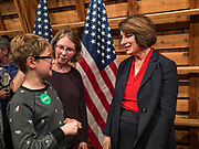 "02 JANUARY 2020 - JOHNSTON, IOWA: US Senator AMY KLOBUCHAR (D-MN), right, talks to people in the ""selfie line"" during her campaign event in the Simpson Barn, an event space in Johnston, a suburb of Des Moines. More than 500 people attended the event, the largest crowd to attend a Klobuchar event so far. Sen. Klobuchar is campaigning to be the Democratic nominee for the US Presidency. Iowa holds the first selection event of the Presidential election cycle. The Iowa caucuses are Feb. 3, 2020.          PHOTO BY JACK KURTZ"