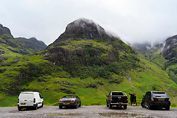 Glen Coe, Scotland, UK. 4 July, 2020. Tourists travel to Glen Coe on first weekend after 5 mile travel restriction was lifted by the Scottish Government. Pictured; Many tourists' cars parked at Glen Coe viewpoint . Iain Masterton/Alamy Live News