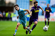 Callum O'Hare of Coventry City and Derby County midfielder Graeme Shinnie  (4) battles for possession during the EFL Sky Bet Championship match between Coventry City and Derby County at the Coventry Building Society Arena, Coventry, England on 23 October 2021.