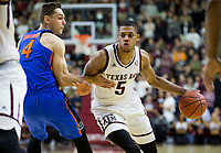 Texas A&M guard Savion Flagg (5) drives past Florida guard Egor Koulechov (4) during the first half of an NCAA college basketball game Tuesday, Jan. 2, 2018, in College Station, Texas. (AP Photo/Sam Craft)