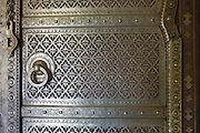 Brass panelling of door to the harem Zenana Deorhi at The Maharaja of Jaipur's Moon Palace in Jaipur, Rajasthan, India