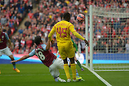 Mario Balotelli of Liverpool crosses the ball over Kieran Richardson of Aston Villa. The FA Cup, semi final match, Aston Villa v Liverpool at Wembley Stadium in London on Sunday 19th April 2015.<br /> pic by John Patrick Fletcher, Andrew Orchard sports photography.