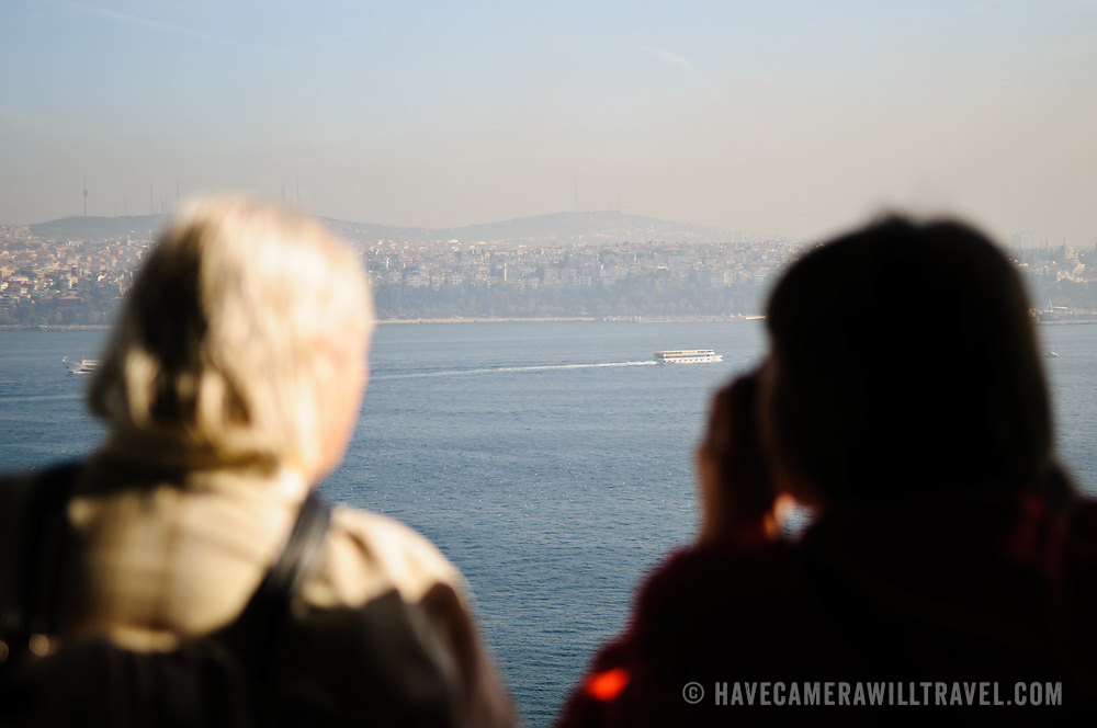 Tourists view the Bosphorus from the Topkapi Palace.