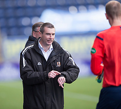 Alloa Athletic's manager Barry Smith at the end complaining about the time .<br /> Falkirk 2 v 1 Alloa Athletic, Scottish Championship game played 4/10/2014 at The Falkirk Stadium.