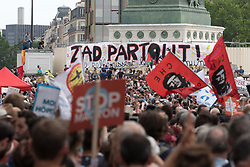 """A little over 30,000 people demonstrated in the streets of Paris for the """"Marée Populaire"""" organised by France Insoumise (FI) and joined by some sixty associations, trade unions and left-wing political parties to protest against the general policies of the government of EMmanuel Macron. Paris, France, May 26, 2018. Photo by Samuel Boivin / ABACAPRESS.COM"""