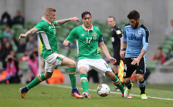 Republic of Ireland's James McClean and Kieren Westwood battle for the ball with Uruguay's Nahitan Nandez during the international friendly at The Aviva Stadium, Dublin.