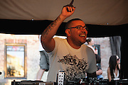 DJ Hector Romero spinning at Sundae.People dancing, partying, and have a good time at Lee Jones's open air Sundae dance party in 2009. This weekly event is held at the the Piazza at Schmidt's in Northern Liberties in Philadelphia each Sunday.