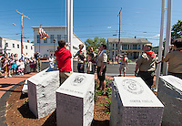 Belmont Boy Scout troop 65 rededicated the War Memorial next to the Belmont Library following the  Memorial Day Parade on Monday afternoon.  (Karen Bobotas/for the Laconia Daily Sun)