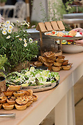 An assortment of foods in bowls on a buffet table during a posh reception