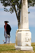29 AUGUST 2020 - RUNNELLS, IOWA: A man in a replica of Revolutionary War era Continental Army uniform at the funeral for Pvt. Roy Brown Jr. in Runnells, IA. Pvt. Brown was a US Army soldier in World War II. He was an infantryman in the 126th Infantry Regiment, 32nd Infantry Division, serving in the Australian Territory of Papua (now Papua New Guinea). He went missing in action on Dec. 2, 1942. Unidentified remains were recovered on Feb. 2, 1943 and were eventually interred in the Manila American Cemetery. On May 14, 2019, Defense POW/MIA Accounting Agency using dental records, circumstantial evidence and DNA identified the remains as Pvt. Brown's. He was reinterred in the Lowman Cemetery in Runnells Saturday.     PHOTO BY JACK KURTZ