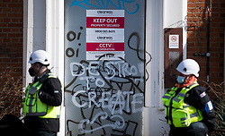 © Licensed to London News Pictures. 29/03/2021. London, UK. Bailiffs guard an entrance to the former Cavendish Road Police Station in Clapham in south London where squatters occupied the building as part of a 'Kill The Bill' protest. Murdered woman Sarah Everard walked past the building on the night she went missing on March 3, 2021. Photo credit: Ben Cawthra/LNP