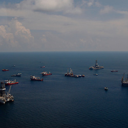 Rigs and support vessels leased by BP Plc at the BP Plc Macondo well site in the Gulf of Mexico off the coast of Louisiana, U.S., on Saturday, August 7, 2010. BP successfully used the 'static kill', procedure  pumping mud into the top of the damaged well, BP plans now to finish a relief well to permanently plug the well by mid-August. Photographer: Derick E. Hingle/Bloomberg