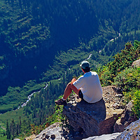 A hiker overlooks a canyon in Glacier National Park, Montana.
