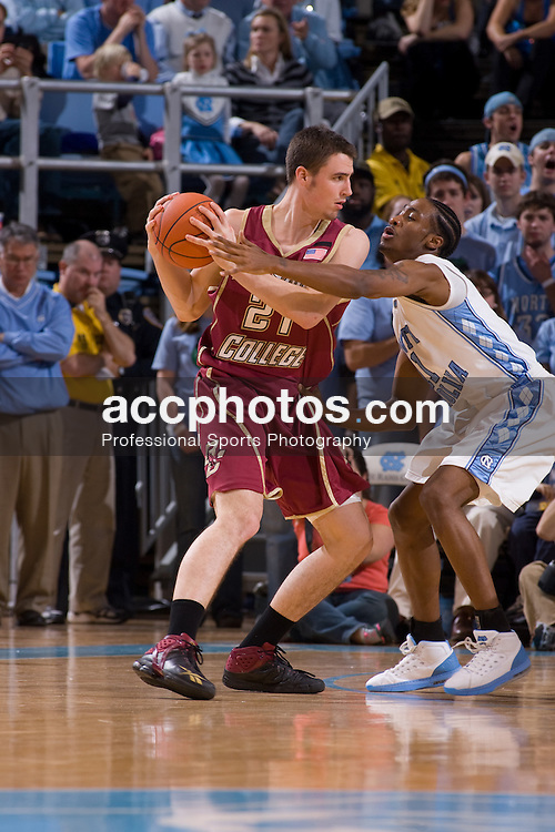 31 January 2008: North Carolina Tar Heels guard Quentin Thomas (11) and Boston College forward Tyler Roche (21) during a 69-91 win over the Boston College Eagles at the Dean Smith Center in Chapel Hill, NC.